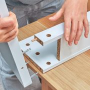 Furniture assembler connects parts of table, furniture assembly.